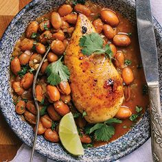 Sweet and spicy chicken tops saucy pinto beans in this easy recipe from Clean Eating. For a change, you can make this dish into a wrap—simply shred the chicken and serve it with the beans in warm w…