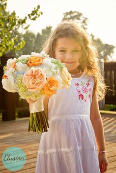 This little girl is so adorable.  The flowers are beautiful and I just love sunflare!