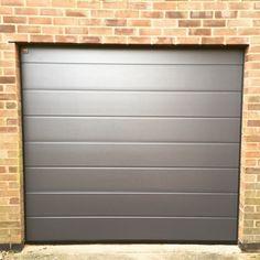 Hormann sectional garage door in grey insulated and remote control Www.bradgatedoors.co.uk     #sectionaldoors #remotecontrol #garagedoor #securedoor #luxurydoor #leicestergaragedoors