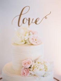 White and blush accented cake: www.stylemepretty...   Photography: Carmen Santorelli - carmensantorellis...