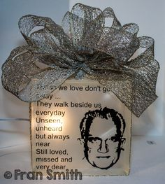 A Glass Block I made in memory of my Dad.  Did the photo and the wording with vinyl