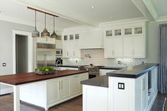 Brooke Wagner Design - kitchens - L shaped kitchen, galvanized metal pendants, long kitchen island, center island.