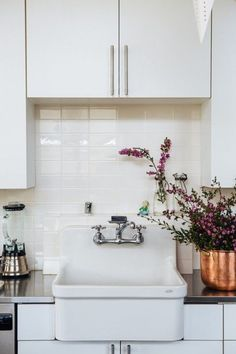 white sink + white cupboards