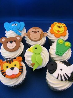 http://www.babyshowerinfo.com/ideas/safari-theme-baby-shower/ Safari/Jungle theme baby shower cupcakes