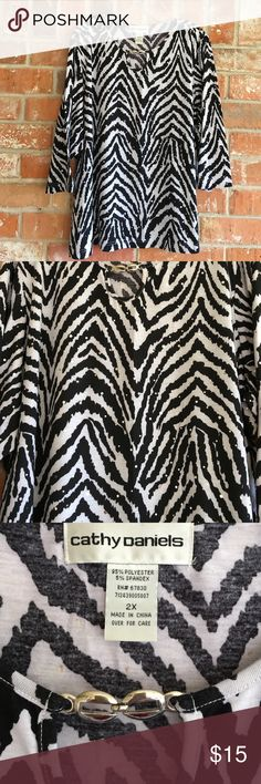 """Beautiful Sparkly Top By Cathy Daniels Plus Size This top is prettier than the pic. No need for a necklace because it has a chain on the collar. I love the zebra print with sparkles throughout. It measures 27"""" underarm to underarm and is 28"""" long. By measurements it will fit a 3X as well. Cathy Daniels Tops Blouses"""