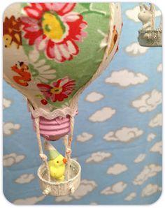 Repurposed Hot Air Balloon Ornament DIY using water bottle caps, light bulbs, and fabric and trim scraps.