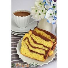 Delicious, fluffy, flavored Vanilla&Cocoa Loaf Cake - perfect with a nice hot coffee 😍💕😊 #delight #dessert #delicious #morningcoffee #morning #coffee #coffeetime #colourful #vanilla #cocoa #cake #cakegram #loafcake #pastrylife #pastrylove #baked #baking #summer #sunnyday #heaven