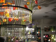 Gorgeous florals in the chandelier, gorgeous flowers scattered wildly around the store - inspiration for wedding reception decor / Ecoya Flagship Store, Woollahra, Sydney