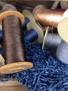 Our artisans' atelier...choosing our color combinations...chenille and silks...soon to become chokers with drops...