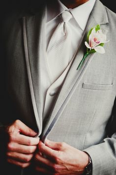 Upclose pic is great, but needs the groom's face looking down at the button.