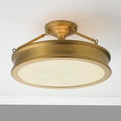 "A striking addition for any room, this handsome ceiling fixture offers sophisticated style and plenty of illumination. A frosted white glass diffuser eliminates glare adding sleek refinement to the satin Antique Brass or Brushed Nickel body. 6.6 lbs.3x100 watt medium base lamp max.(9.75""Hx19""W)"