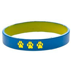 This Blue and Yellow Paw Print Wrist Band is a two-tone silicone bracelet that features three yellow paw prints engraved into each one.