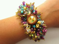 Very fun!!! how about a watch face in the middle of allllll those pearls and crystals!!!!???