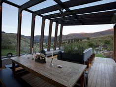 Secondary shot of only external part of indoor/outdoor patio. Located above Lake Hayes in Queenstown, New Zealand; 12M 7/2012