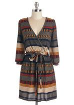 Flaunt your anything-but-ordinary city style in this richly patterned dress. Striped panels of navy-blue, gold, and rusty-red adorn the 3/4-sleeved silhouette of this knit frock, wrapping you in elegance that can't be topped!
