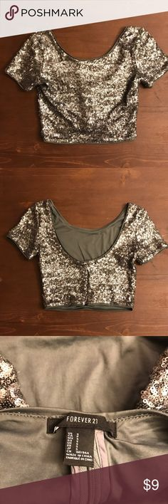 Eye catching sequin crop top! Sequin silver crop top by F21. Zipper up the back, short sleeves. Worn once for NYE. Looks amazing with high waisted skirts or pants! Forever 21 Tops Crop Tops
