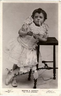 I am guessing she is a circus entertainer. Or just a bad-ass midget.