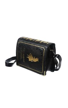 "In my Book Heaven, I would own this Alice In Wonderland Bag. Best looking ""book purse"" i've ever seen"