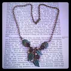 """Vintage brass enameled leaf rhinestone necklace Vintage brass necklace featuring green enamel leaves with purple rhinestones. It is signed, but I can't make it out. A little wear due to age, mostly on the back where it will go unnoticed when worn. Charming vintage piece to add to any wardrobe or outfit. 16"""" in length. Good vintage condition. Vintage Jewelry Necklaces"""