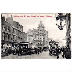 Electric Car St John Street and Angel, Islington - Postcard by Charles Martin on eBid United Kingdom Electric Car, Big Ben, Postcards, United Kingdom, Louvre, Buy And Sell, Angel, Street, Travel