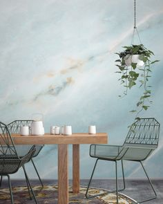Soothing blues work beautifully in dining room spaces. This marble wallpaper design brings a tranquil feel to your home and looks stylish at the same time. Pair with a hanging planter to complete the look!