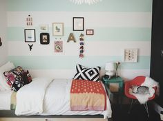 Love the bold stripe. Maybe on one wall like originally planned? Just a cute room.