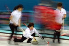 Ayumi Ogasawara of Japan delivers the stone during the Curling Women's Round Robin match between Japan and Great Britain (c) Getty Images