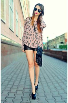 Leopard and black leather ! Leather top paired with leather (pleather) shorts, bag, heels, and killer aviators !