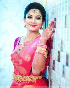 South Indian bride. Gold Indian bridal jewelry.Temple jewelry. Jhumkis. Pink and purple silk kanchipuram sari.Braid with fresh jasmine flowers. Tamil bride. Telugu bride. Kannada bride. Hindu bride. Malayalee bride.Kerala bride.South Indian wedding.
