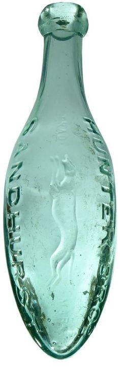 unter Bros Sandhurst. Greyhound trade mark. Lengthwise embossing variation. Torpedo bottle. Excellent. Minor scuffs and marks.  $2,550