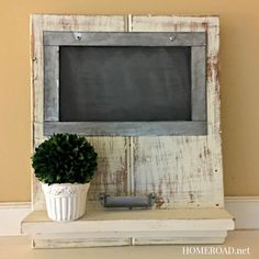 Make your own distressed chalkboard shelf with a cup handle as a chalk holder! www.homeroad.net