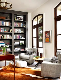 Home office with built-in bookshelves - dark bookcases to match window trim