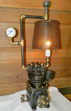 Steampunk table lamp, made with parts from an old air compressor and other scrap metal.