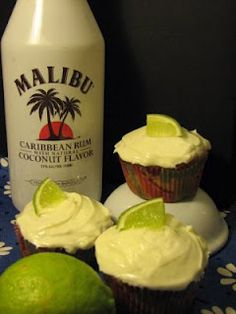 Malibu Pina Colada Cupcakes with Lime Cream Cheese Frosting    I have many criteria for a perfect vacation.  One of them is that for some part of the vacation I get to sit on the beach (or by a pool, if I must) while a man with a tray brings me pina coladas.  If that man were to bring me a cupcake instead of a drink, he would bring me these.    Sta
