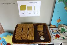 Montessori decimal system - golden beads supply basket. Read more about our Decimal System learning journey!