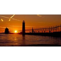 Grand Haven Lighthouse at sunset Grand Haven Michigan USA Canvas Art - Panoramic Images (24 x 12)