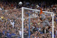 Wigan Athletic's goalkeeper Ali Al Habsi saves the ball during their English Premier League match against Chelsea Stamford Bridge in London, April 9, 2011.  REUTERS/Stefan Wermuth