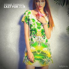 Fresh and feminine, a fitted A-line silk dress cut, charms with a lush floral print splashed with vibrant green and yellow. The back has a wide keyhole that rev