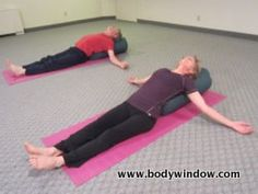 The highly relaxing, heart opening Supported Fish Pose.  If this stretch is too intense for your shoulders, place a cushion or rolled up blanket under each arm.