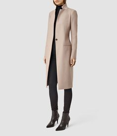 NEHRU COATOur outerwear this season reflects the structural elongations of London's skyline to provide slim-line, tailored options to finish any outfit.Slim fitting, crafted from a wool blend to insulate during colder seasons.A style that endures from season to season, the Nehru Coat is finished with a contrast patch stand collar and slim jet pockets.WORN WITH:Our Albar Roll Neck, and the Grace Jeans, Elmore Jeans.  SIMILAR STYLES:The Lorie Coat. The Anise Coat.HOW TO WEAR THIS SEASON:Wear…