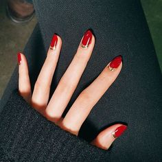 Make a red nail instantly more glamorous with a metallic accent. Start with a clear base coat and then paint your half moons in gold. Let dry then fill in the rest of the nail in your favorite red polish. Finish with a topcoat.