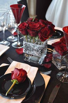 white, red, black, Centerpieces, Winter Wedding Flowers & Decor--I like the damask ribbon on vase. 9 roses in cube without greens