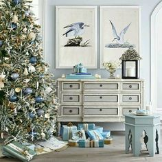 beautiful upscale coastal Christmas decor....tree, love the bird prints
