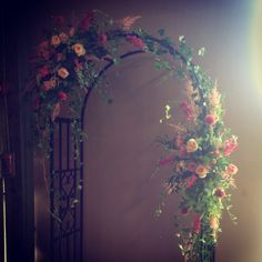 This with arch made out of branches or sticks instead of rod iron. Add white lights Wedding arch