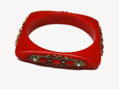 For your consideration is this unique #geometric #square bangle. It consist of a   dark round #red plastic in a geometric square design. It is decorated with a gold tone ornat... #vintage #bracelet #bangle #teamlove #burgundy #lucite #turquoise