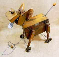 Woody robot dog pull toy assemblage sculpture