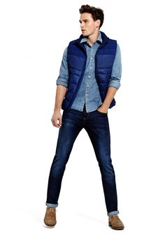 Pairing a navy gilet with dark blue jeans is a comfortable option for running errands in the city. Choose a pair of camel suede brogue boots to show your sartorial savvy.   Shop this look on Lookastic: https://lookastic.com/men/looks/navy-gilet-blue-denim-shirt-navy-jeans/15797   — Blue Denim Shirt  — Navy Gilet  — Navy Jeans  — Tan Suede Brogue Boots