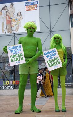Indian activists from The People for the Ethical Treatment of Animals (PETA) pose wearing green body paint holding placards during a demonstration in Hyderabad on April 22, 2013, on World Earth Day.