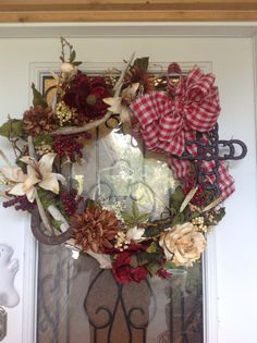 Western wreath using deer antlers, horseshoes, western horseshoe cross with burlap bow and used the neutral color all around. (Sold)