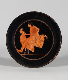 Terracotta plate The man is riding a Rooster and touches the bird on the neck. This plate was meant as a love gift. 18.7cm in diameter (7 3/8 inch.) Greek, Attic, Archaic period, 520 - 510 BC. Source: Metropolitan Museum of Art